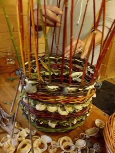 A foraged fiber basket in progress