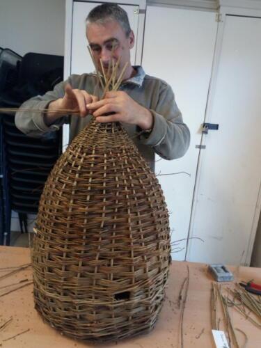 Ian weaving a bee skep